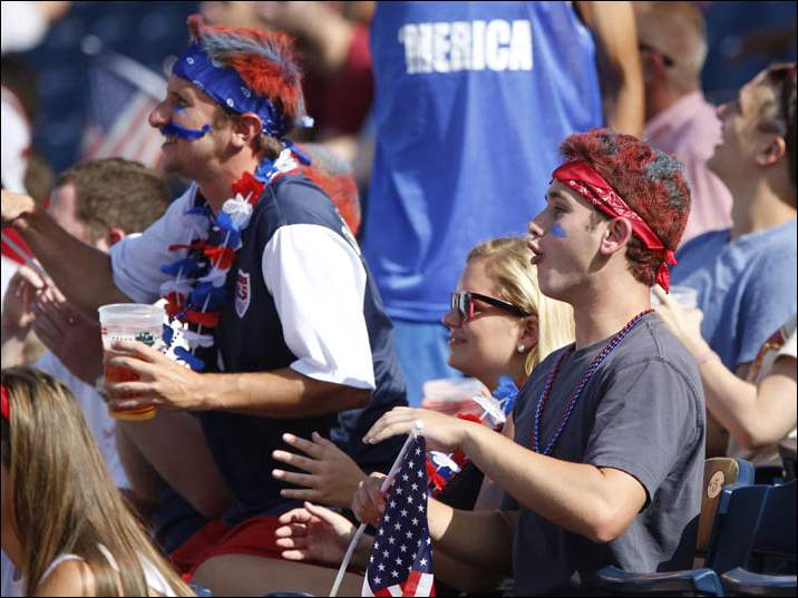 Fans react to USA missing a goal opportunity against Belgium in the World Cup competition at Fifth Third Field in Toledo, Ohio.