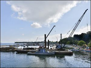 Work is done on C-Dock at Put-in-Bay.