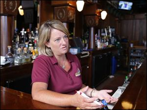 Jennifer Blumensaadt, owner of Mossbacks Island Bar & Grille, speaks about the marina construction at Put-in-Bay.