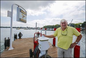 Marv Booker, owner of the Boardwalk Family of Restaurants, including The Keys, Hooligans, and Dairy Isle,  says sales have been down about 15 percent  this summer as dock construction continues.