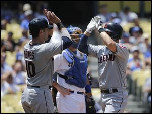 Cleveland Indians' Ryan Raburn, right, celebrates his two-run home run with Yan Gomes.
