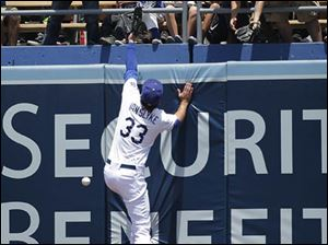Los Angeles Dodgers right fielder Scott Van Slyke can't catch a double hit by Cleveland Indians' Asdrubal Cabrera.