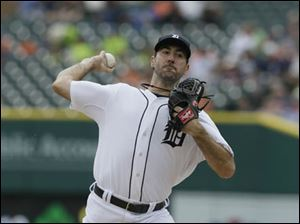Detroit Tigers starting pitcher Justin Verlander throws against the Oakland Athletics.