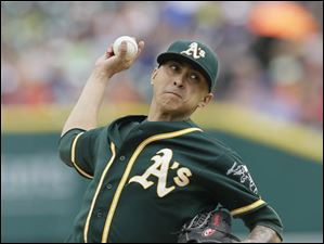 Oakland Athletics starting pitcher Jesse Chavez throws against the Detroit Tigers.