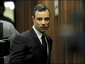 Oscar Pistorius arrives at court in Pretoria, today. His trial continues with evidence being heard from his agent testifying being tried at the double-amputee runner's murder trial surrounding the death of his girlfriend Reeva Steenkamp.