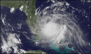 A satellite image released by the National Oceanic and Atmospheric Administration Tuesday, shows the center of Tropical Storm Arthur off the east coast of Florida.