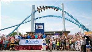 Cedar Fair CEO Matt Ouimet rings the closing bell of the New York Stock Exchange at Cedar Point in Sandusky.