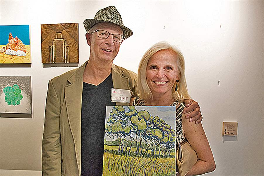 Deb-Calabrese-poses-with-proud-artist-Jeff-Anderson-JPG