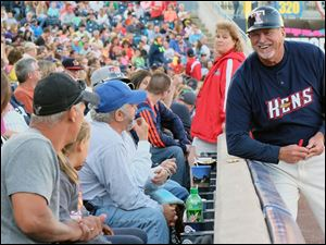 Toledo Mud Hens manager Larry Parrish jokes with fans.