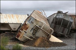 The train was carrying sand that is used in the fracking industry, but the derailed cars contained no hazardous materials.