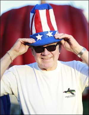 Denny Brown of Florida poses for a portrait with his America-themed hat at the Star Spangled Banner celebration held at Fort Meigs in Perrysburg, Ohio.