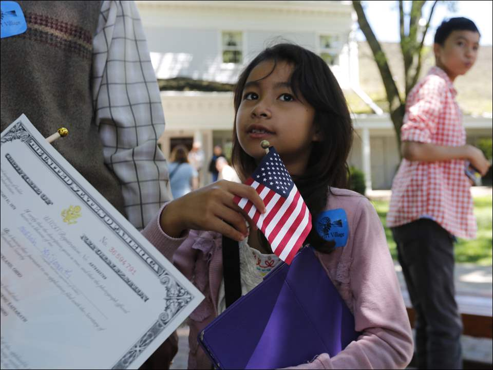 """Freedom, freedom, freedom"", repeats Sarah Xaiyarath, 7, of Northwood, answering for her mother, Martha Vieng Xaiyarath about why she became a U.S. citizen."