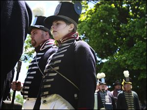 Hannah Grohowski, center, marches with other reenactors.