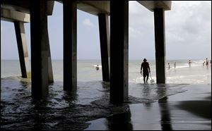 Tourists enjoy a calm ocean in Nags Head, N.C., Thursday. With all the tourists ordered out of the Outer Banks ahead of Hurricane Arthur, only the locals allowed to stay behind will go to bed with a category 2 storm rumbling past.