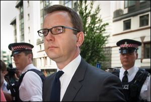 Former News of the World editor Andy Coulson arrives at the Old Bailey court to be sentenced,  in London,  today. Coulson, 46, has been found guilty of being involved in the conspiracy to hack into the phone voicemails of many celebrities, royals, politicians and ordinary members of the public, at the now-closed British Sunday tabloid newspaper.