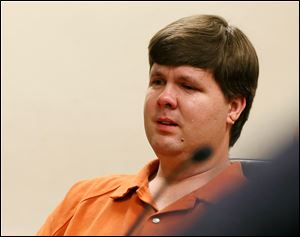 A tear rolls down the cheek of Justin Ross Harris, the father of a toddler who died after police say he was left in a hot car for about seven hours, as he sits during his bond hearing in Cobb County Magistrate Court, Thursday in Marietta, Ga.