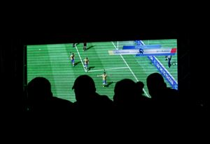 People watch a video game during the FIFA Interactive World Cup 2014 Grand Final at Sugar Loaf, Rio de Janeiro, Brazil, Thursday.