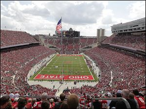Ohio State plays against Florida A&M at Ohio Stadium in Columbus on Sept. 21, 2013. Ohio State was second in the nation last year in attendance with an average crowd of 104,933 and has since added 2,522 seats to the south stands in the Horseshoe.