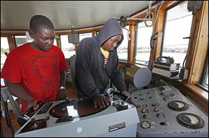 Justin Perry, 12, and his brother Christopher Perry, 13, of Fort Wayne, Ind., examine the pilot room of the S.S. Col. James M. Schoonmaker.