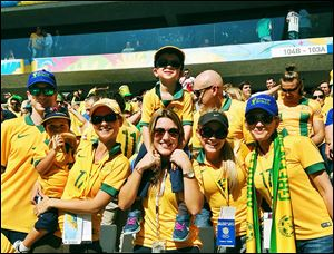 Ivi Casagrande, center, bonded with many families of the Australian men's soccer team, including Matt McKay's family.