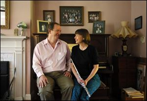 Lee and Amy Heritage, pictured at their home in Toledo. Lee Heritage is a composer and professor of composition at UT and Amy Heritage is a second flutist in the Toledo Symphony.
