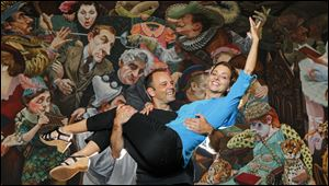 Dancers Michael Lang and Lisa Mayer in front of a mural at the Valentine Theater,
