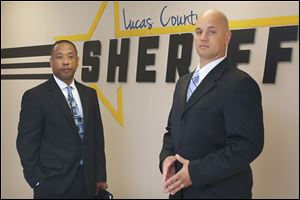 Lucas County sheriff's deputies Charles Johnson, left, and Damian Worthy are two members of a new initiative that focuses on helping addicts seek treatment. The deputies work with the families of addicts and make house calls on people who are on record as having overdosed in the past year.