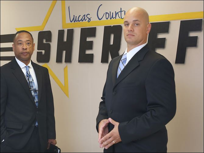 n1deputies-2 Lucas County sheriff's deputies Charles Johnson, left, and Damian Worthy are two members of a new initiative that focuses on helping addicts seek treatment. The deputies work with the families of addicts and make house calls on people who are on record as having overdosed in the past year.