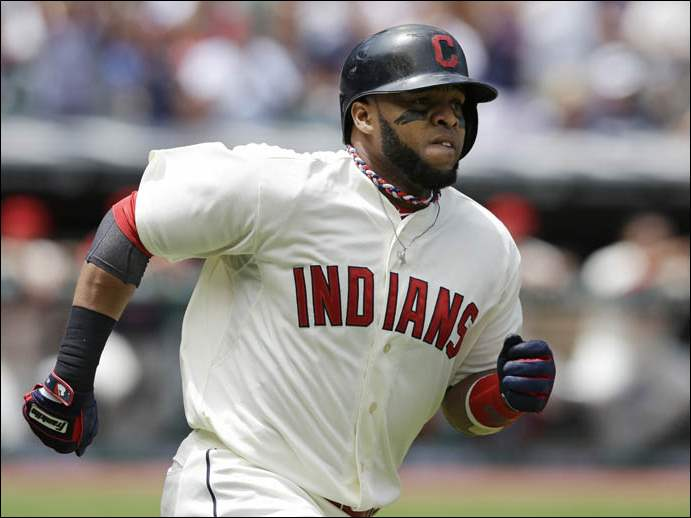 Cleveland Indians' Carlos Santana runs the bases after hitting a solo home run off Kansas City Royals starting pitcher Danny Duffy.