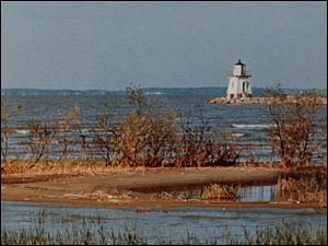 A historic photo from the Ottawa County Museum of the Port Clinton lighthouse.