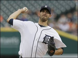 Detroit Tigers starting pitcher Rick Porcello throws a pitch.