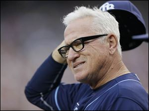 Tampa Bay Rays manager Joe Maddon is seen in the dugout.