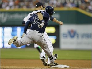 Detroit Tigers starting pitcher Rick Porcello beats Tampa Bay Rays' Kevin Kiermaier to the bag for the out.