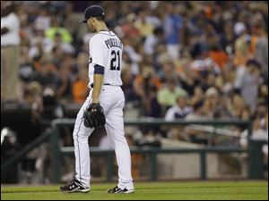 Detroit Tigers starting pitcher Rick Porcello walks to the dugout after being relieved during the sixth inning.