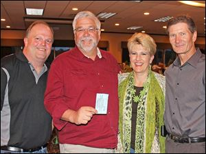 Past President Pat Baker with Golf Ball Drop $2,000 winners Paul and Cathy Hugelet and Rotarian Dick Helminiak.