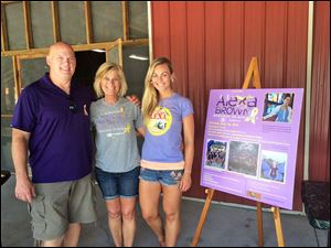 Warren and Wendy Brown, along with their daughter Amanda, raise funds for the Alexa Brown Memorial Scholarship in the name of their daughter and sister.
