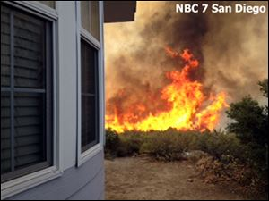 Flames near a home near the San Diego County mountain town of Julian in Southern California.