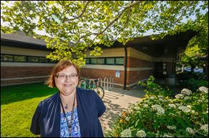 Lisa Green, branch manager at the Oregon Branch Library, says patrons will like the larger, improved library after the renovations. Temporary quarters will be at the old Wynn Elementary School.