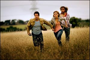 "From left,  Mark Wahlberg as Cade Yeager, Nicola Peltz as Tessa Yeager, and T.J. Miller as Lucas Flannery, in ""Transformers: Age of Extinction."""