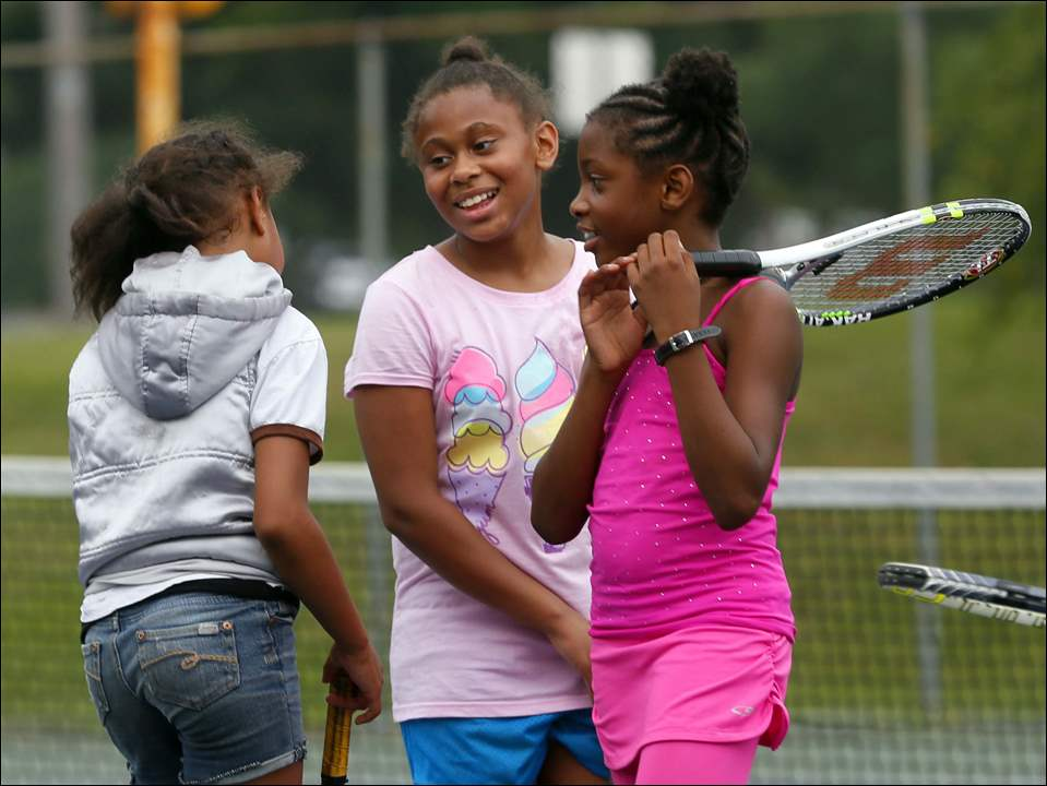 Mariyah Barker, 9, left, Ava Keith, 10, center, and Tatiyana Esmond, 8, right, take a moment away from lessons to socialize.