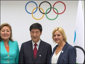 Representatives of the 2022 Olympic Games candidate cities, from left: Amanzholova Zauresh, vice-mayor of