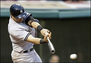 New York Yankees' Francisco Cervelli hits off Cleveland Indians relief pitcher Kyle Crockett in the third inning.