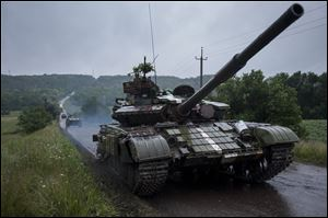 Ukrainian tanks roll to the base in Devhenke village, Kharkiv region, eastern Ukraine, Monday.