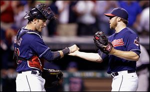 Cleveland Indians relief pitcher Cody Allen, right, is congratulated by catcher Yan Gomes after the Indians defeated the New York Yankees.