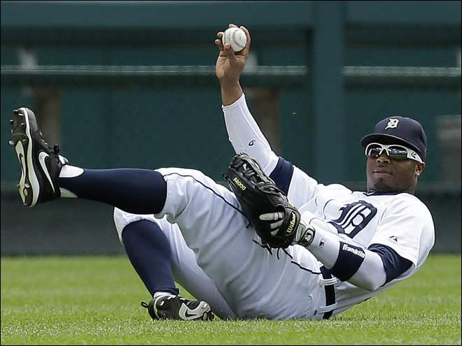 Detroit Tigers left fielder Rajai Davis holds up the ball after catching a Los Angeles Dodgers first baseman Adrian Gonzalez fly ball.