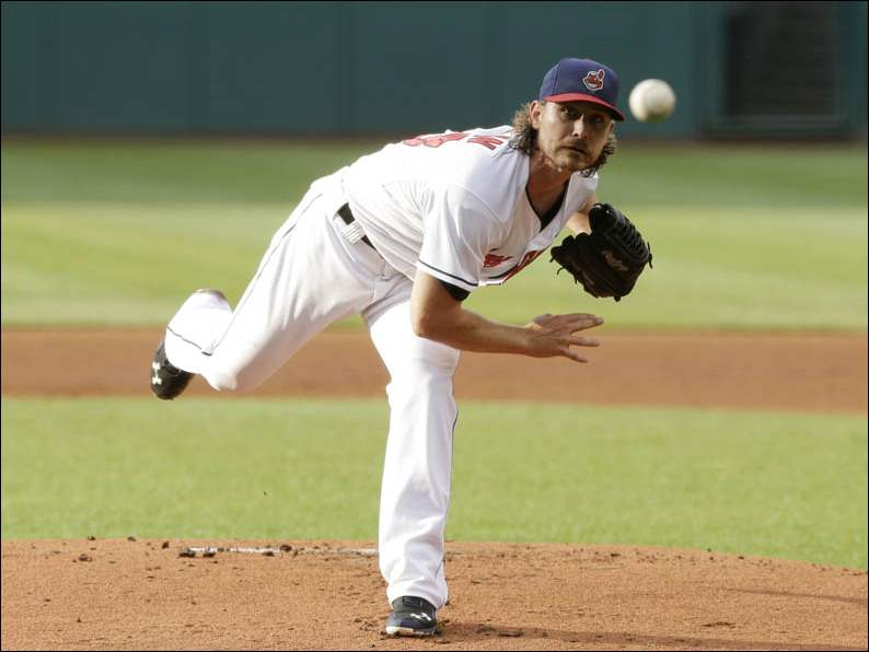 Cleveland Indians starting pitcher Josh Tomlin delivers  against the New York Yankees.