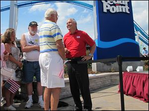 Matt Ouimet, chief executive of Cedar Fair Entertainment Co., greets a guest at Cedar Point amusement park.