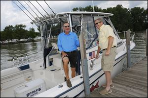 Ohio Governor John Kasich, left, and Jim Zehringer,  Director of the Ohio Department of Natural Resources, return to Port Clinton after a fishing trip on Lake Erie on Wednesday.