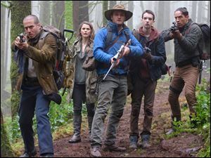 From left, Kirk Acevedo, Keri Russell, Jason Clarke, Kodi Smith-McPhee and Enrique Murciano in a scene from the film.