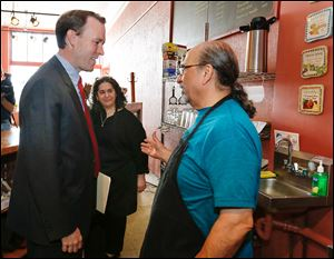 Ed FitzGerald, Democratic candidate for governor, left, meets with Jackie David and her husband Sargis David at their Original Sub Shop on Broadway Street in South Toledo.
